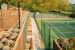 Landscape gardening - Godalming - Roots & Shoots - A new tennis court area near Guildford