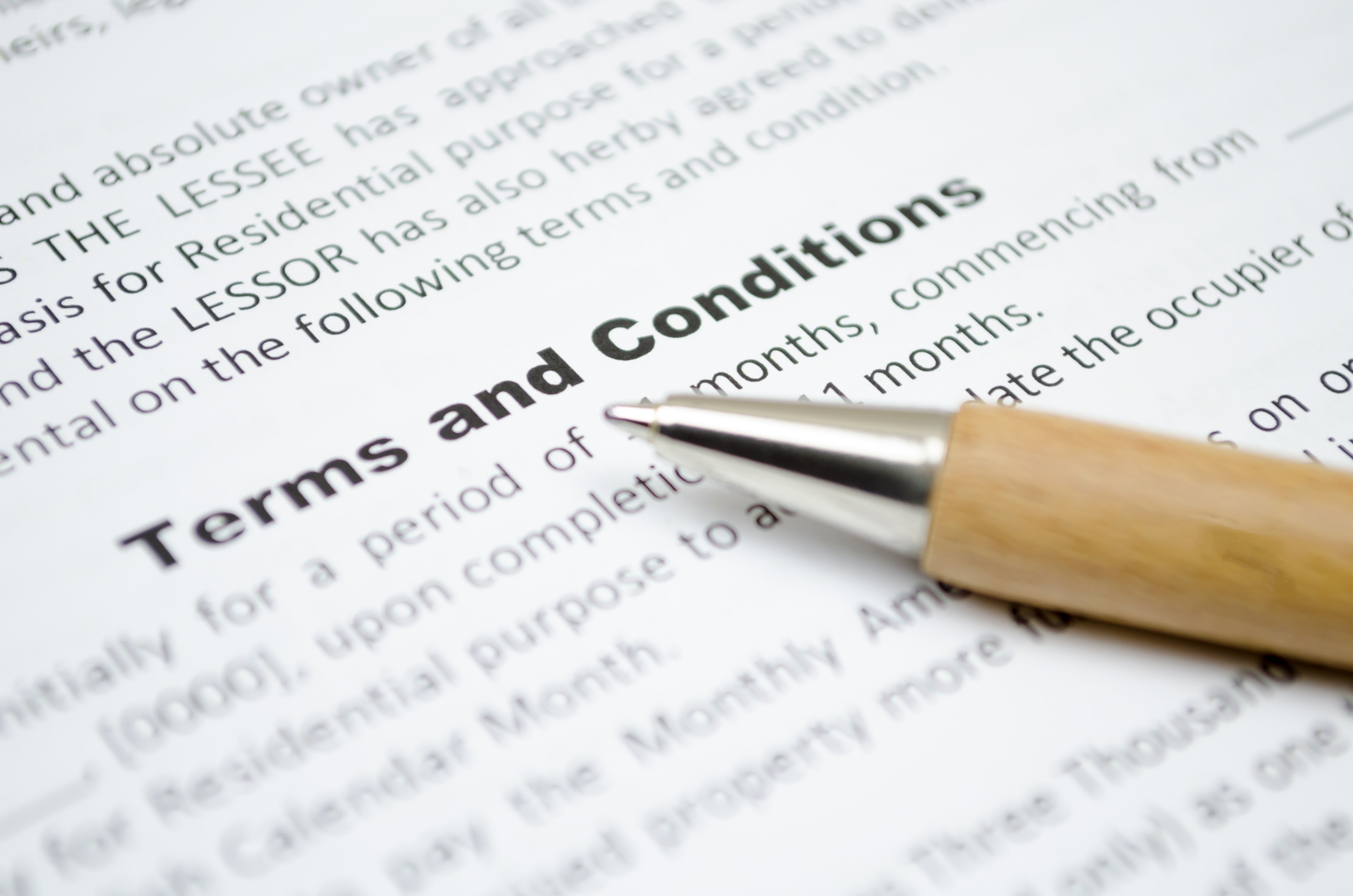 terms and conditions and a pen