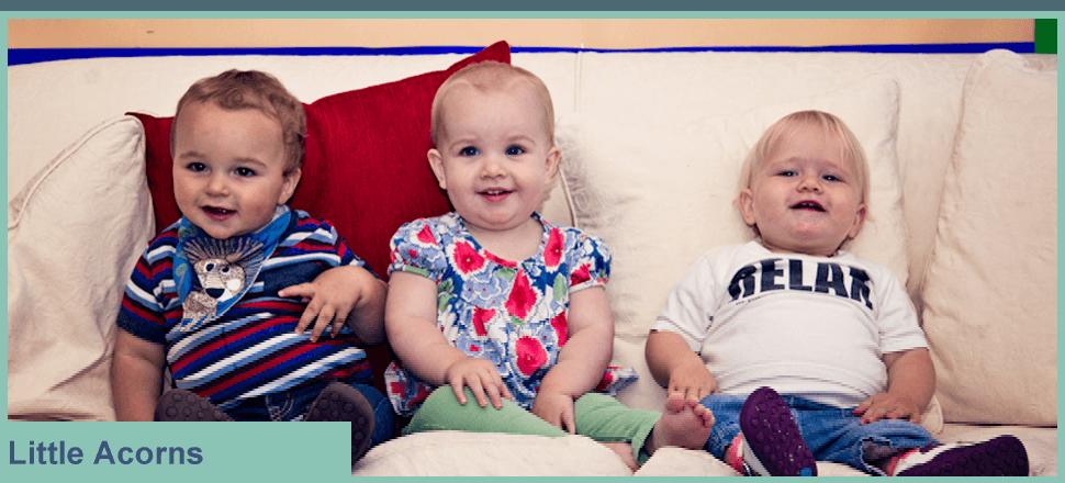 3 children sat on a sofa