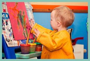 Little boy creating a masterpiece