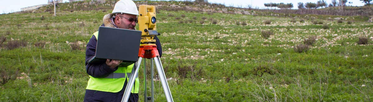 Surveyor with computer in field