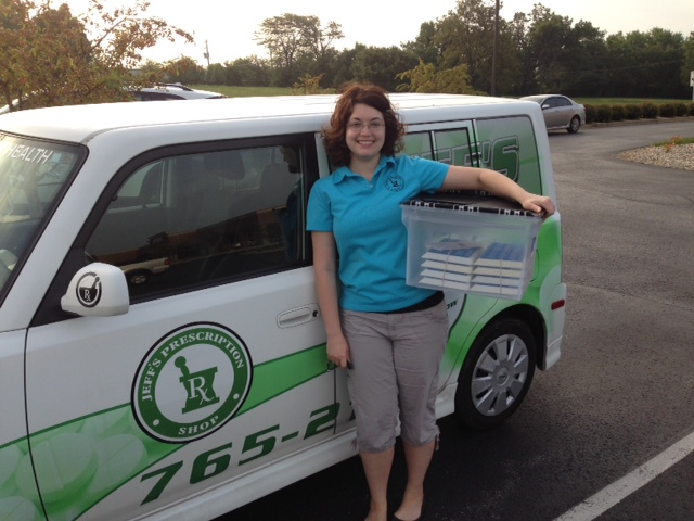 Sarah Volz, Medi-Planner for Jeff's Prescription Shop standing outside of company truck