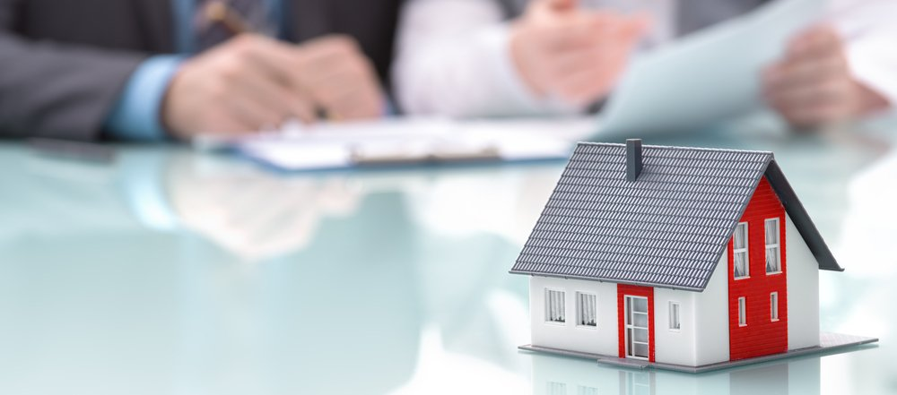Homeowners signing documents after bankruptcy