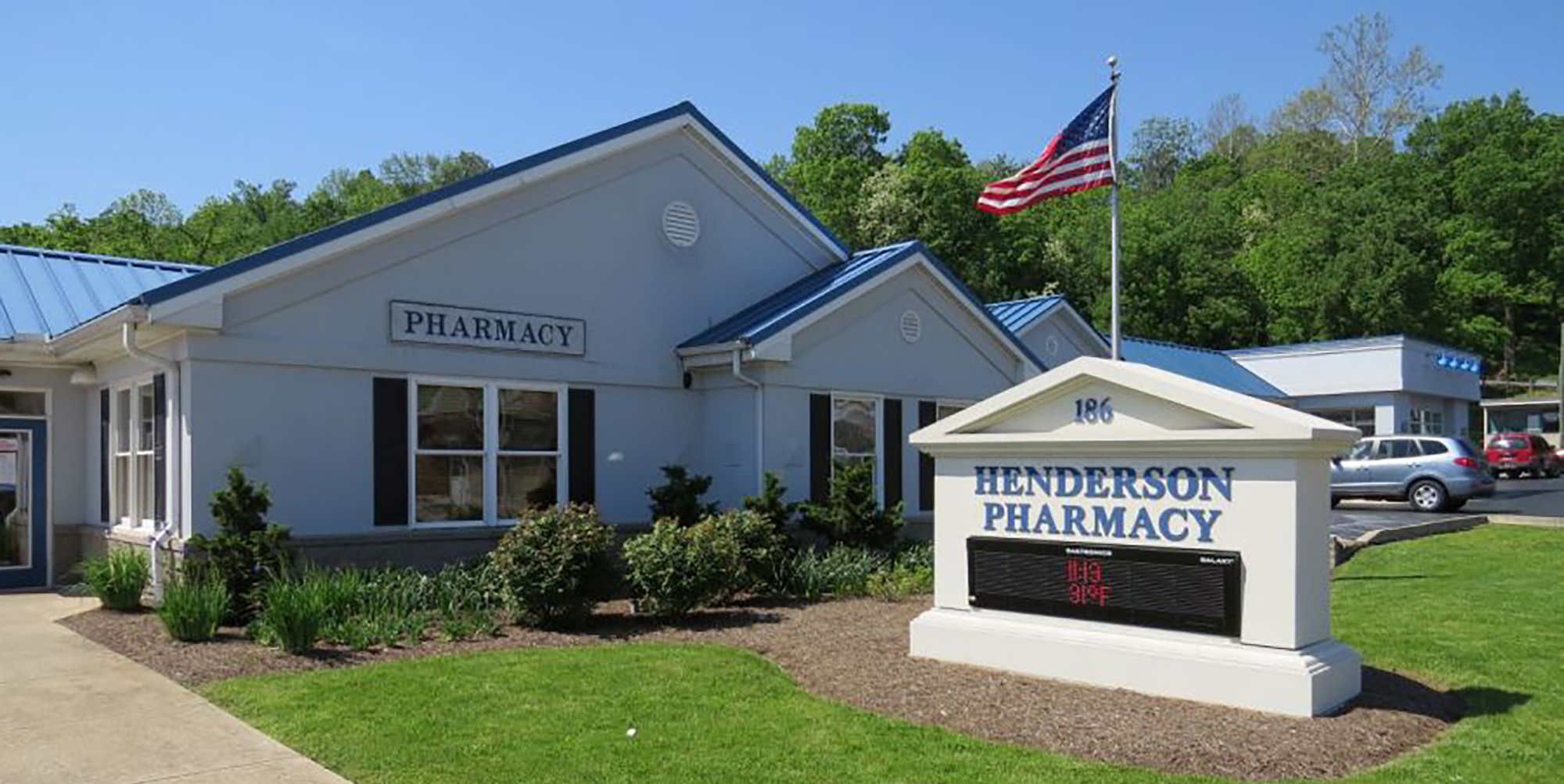Henderson Pharmacy building and sign
