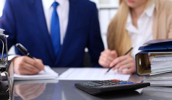 Businessman and secretary checking financial document