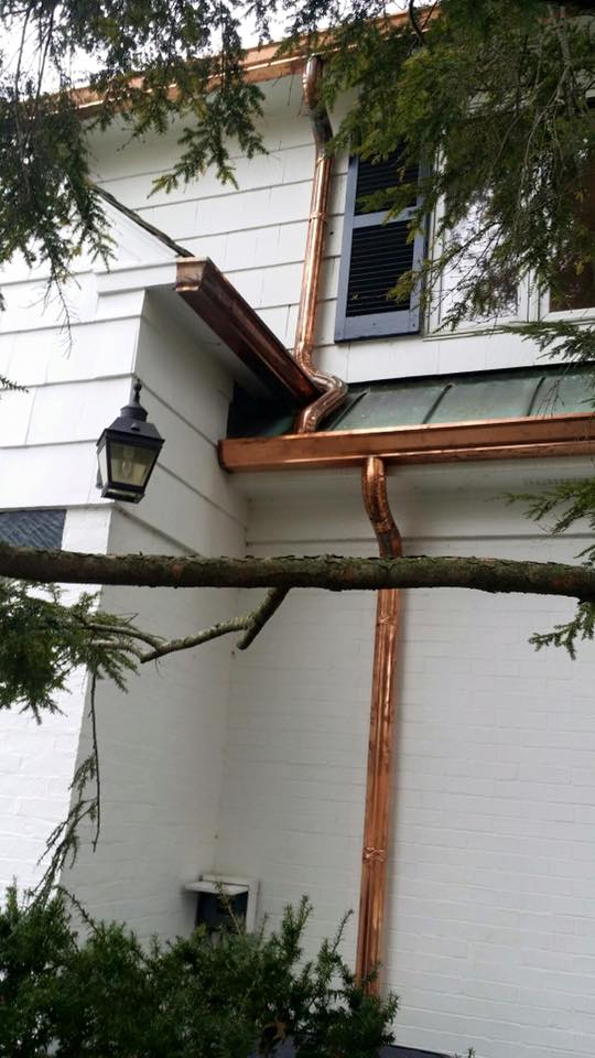 Copper gutters with copper pipe