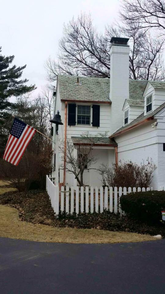 Gray roof house with american flag