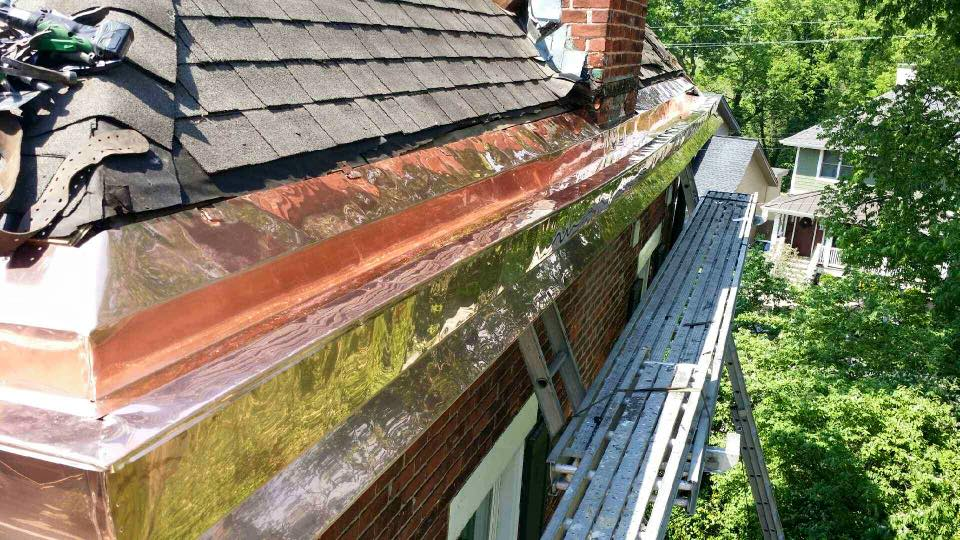 Excel copper works on house roof side