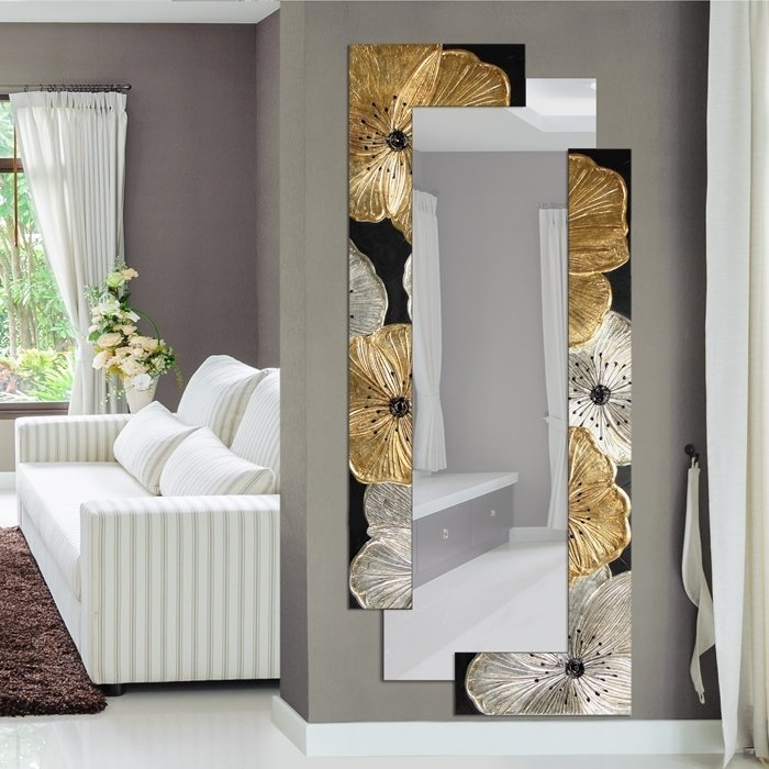specchio con cornice fiorata oro e nero