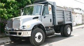 veicoli attrezzati per carico, scarico rifiuti ferrosi, trasporto di rifiuti pericolosi