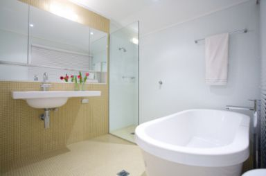 bathroom with a glass shower