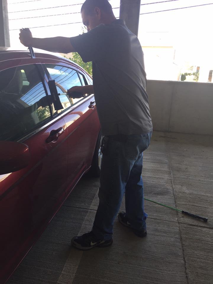 Locksmith opening a car