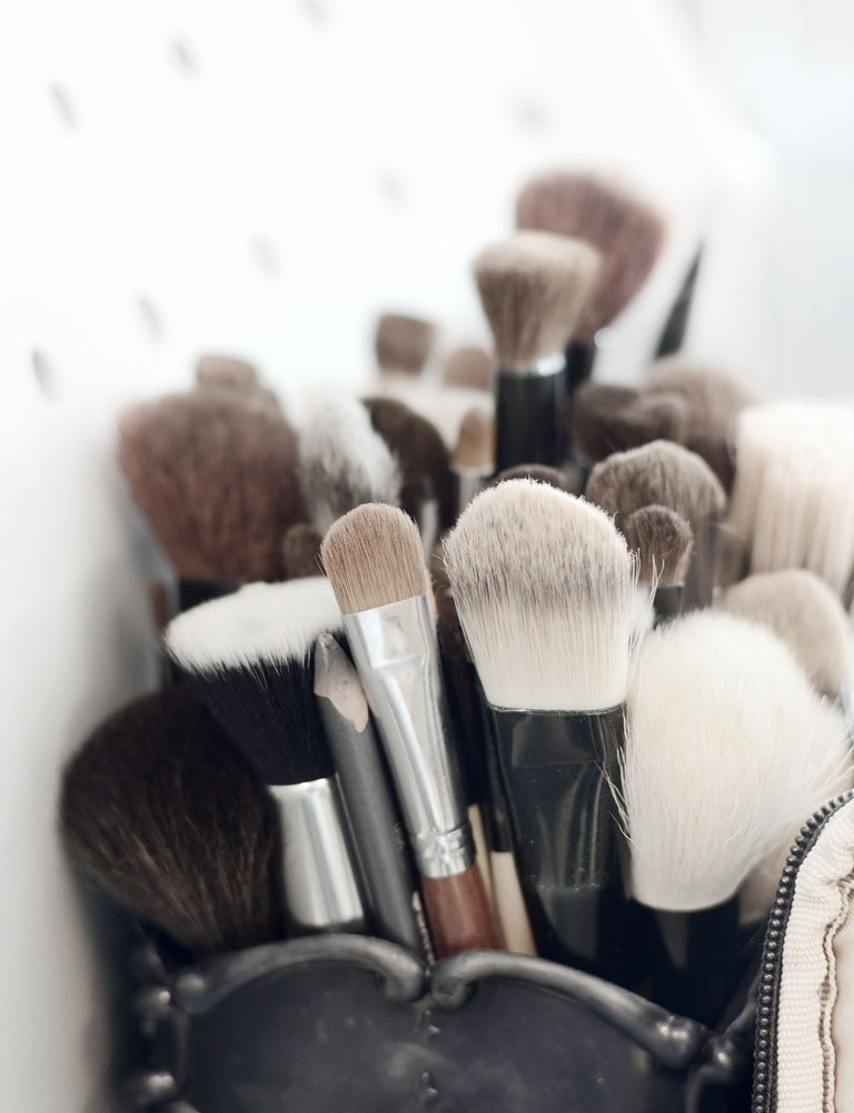 A picture of a collection of makeup brushes