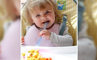 a small girl eating