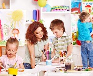 children with the nursery staff