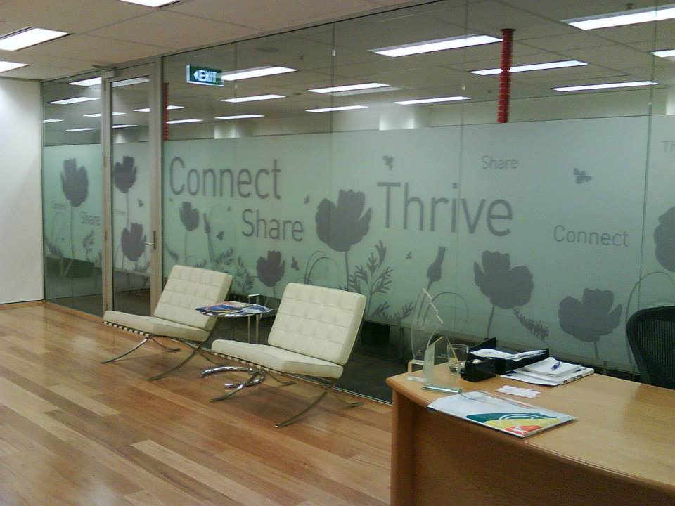 thrive business signs on glass walls