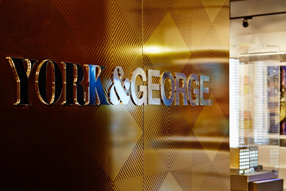 york & george sign on gold wall