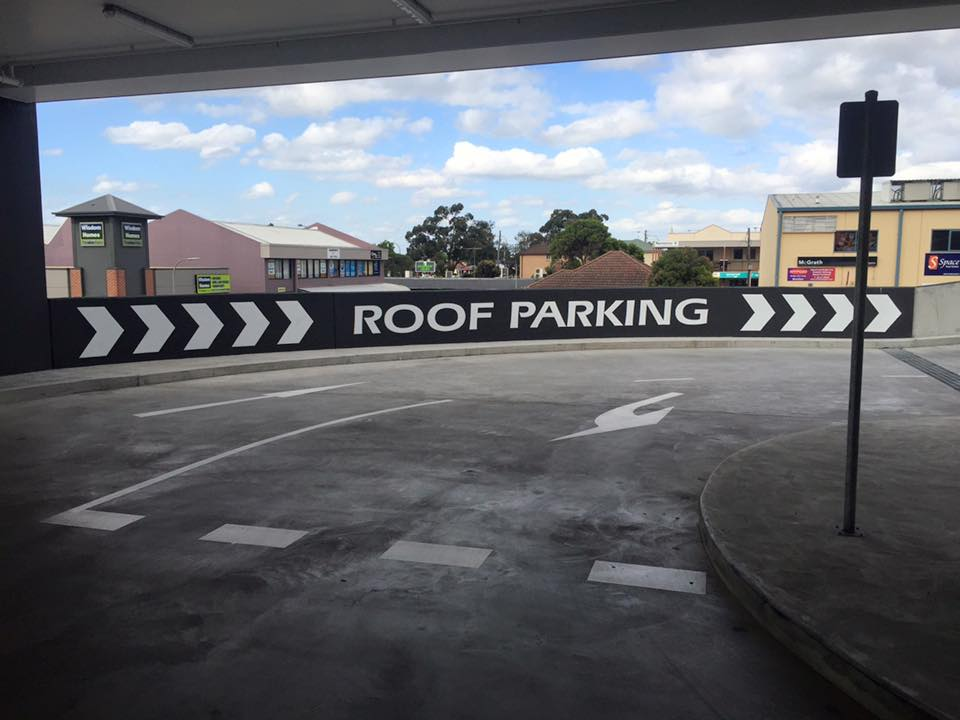 roof parking sign on side of road