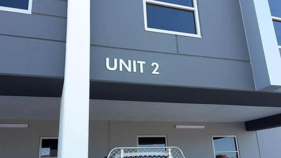 unit 2 building sign