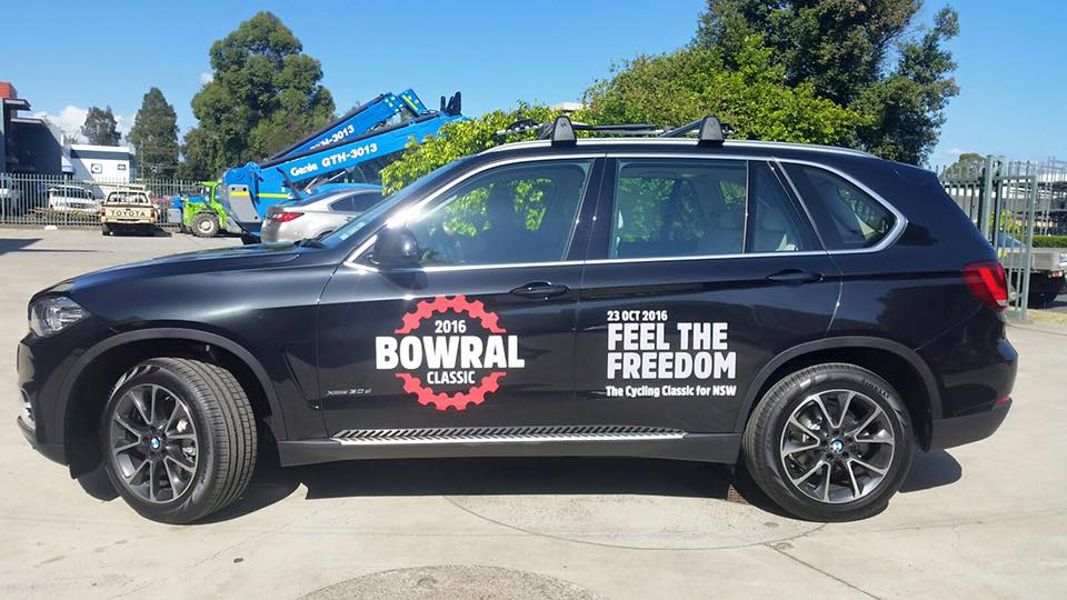 bowral classic signs on side of black car