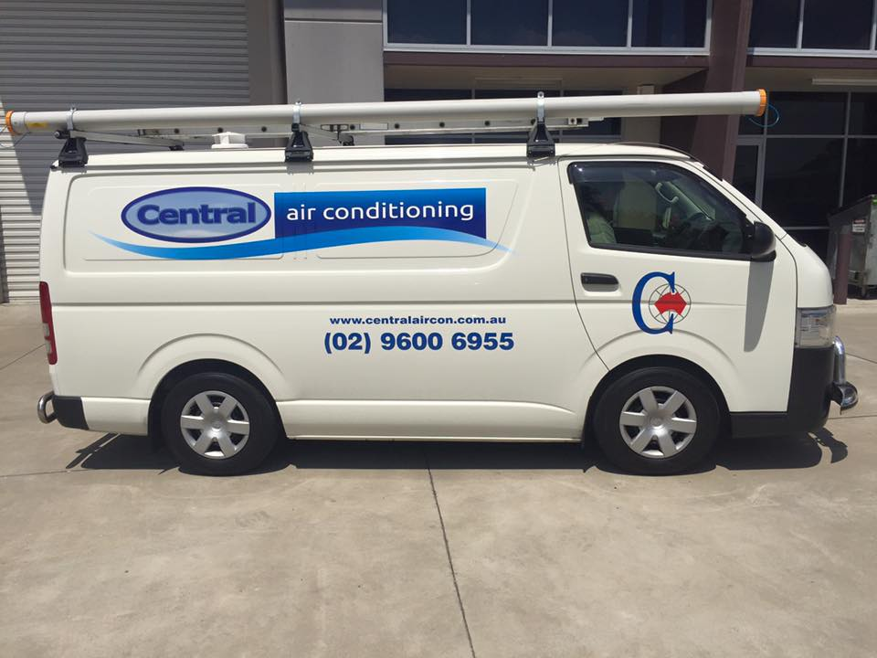 central air conditioning sign on side of van