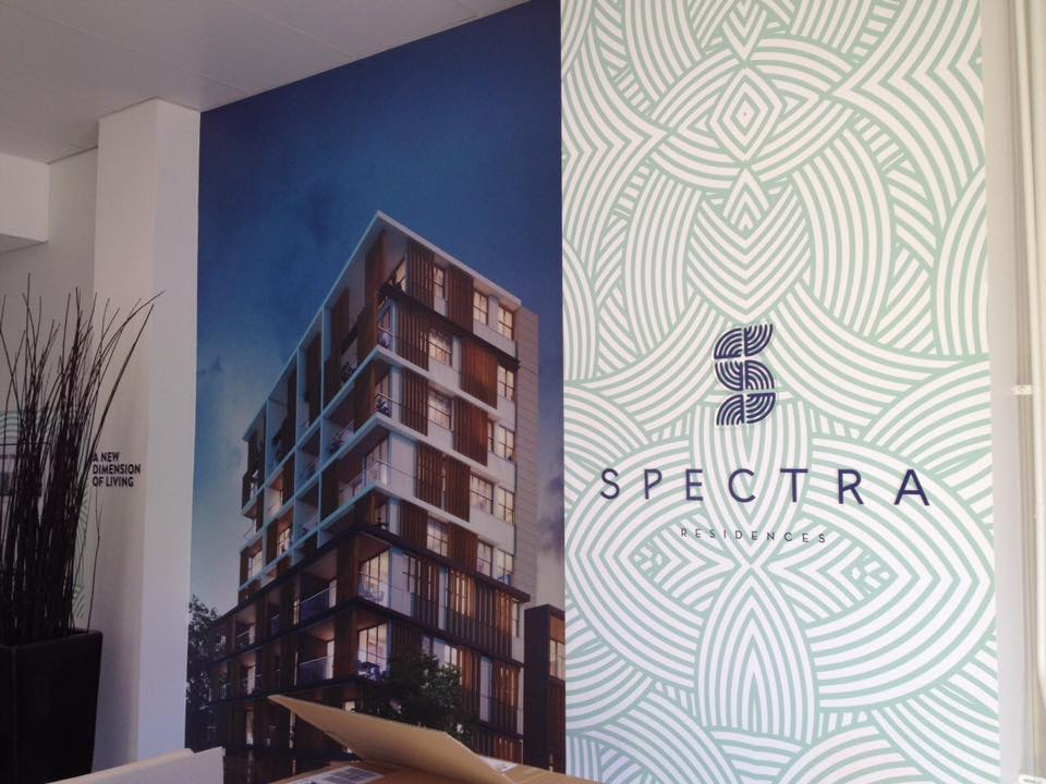 spectra sign on wall