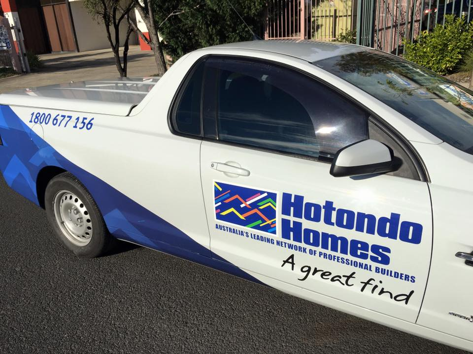hotondo homes sign on side of car