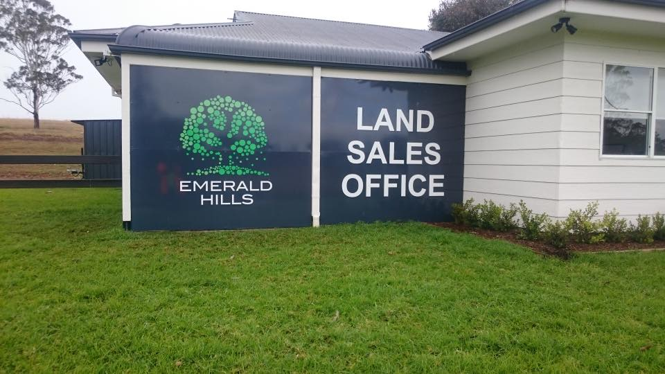 land office sales and green tree signs