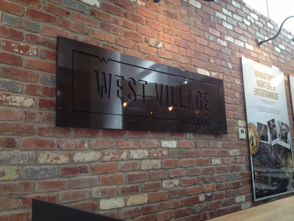 west village 3d cut out logo on brick wall