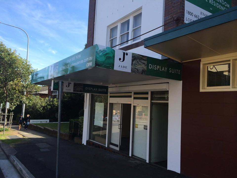 second view of jade logo above store awning