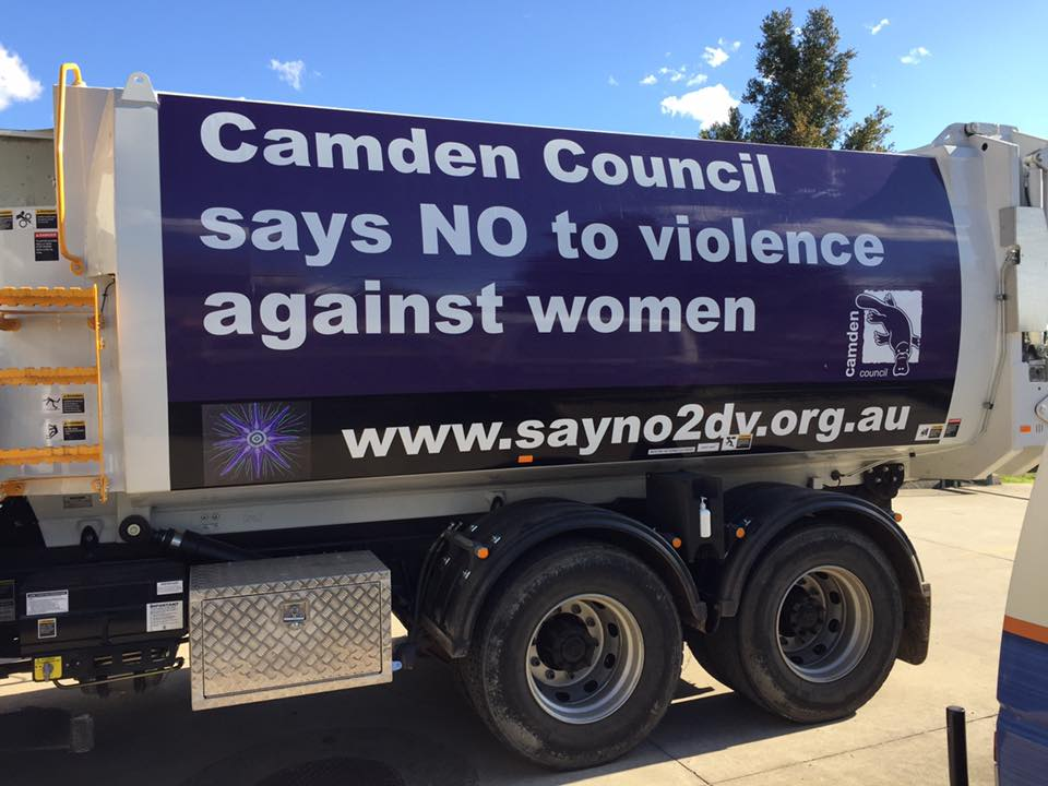 no violence against women sign on truck