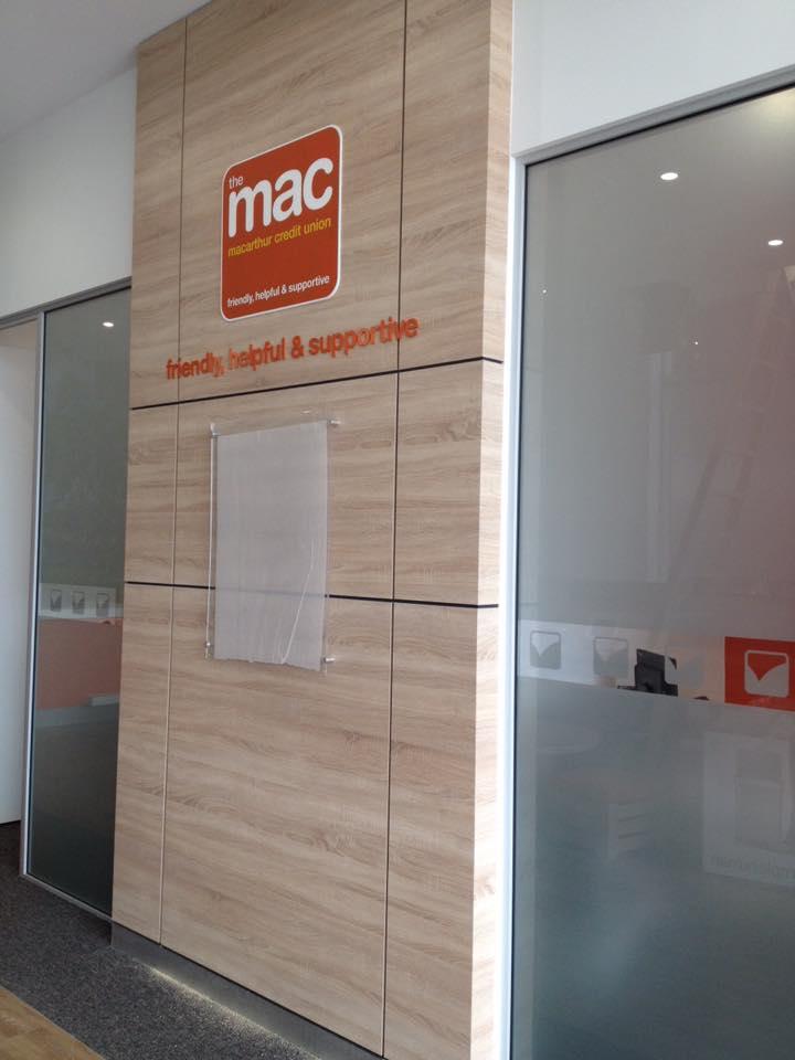 mac sign on modern tan wall