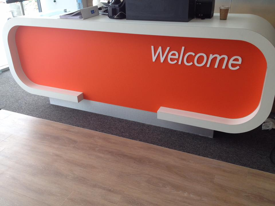 orange welcome sign on front desk