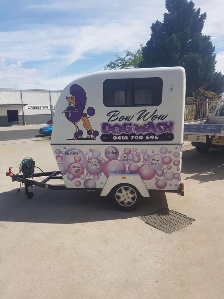 bow wow dog wash sign on trailer