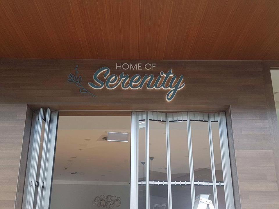 home of serenity sign above shop door