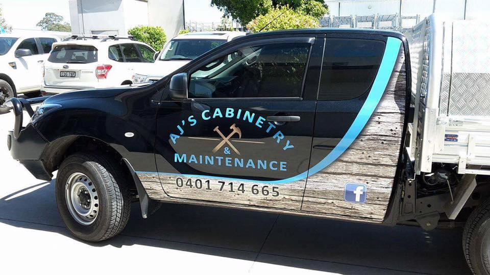 aj's cabinetry maintenance logo on side of truck