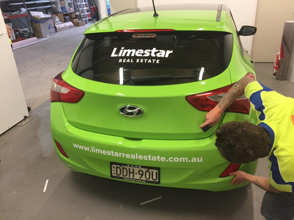 limestar sign on the back window of small car
