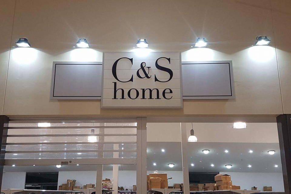 c & s home sign above shop door