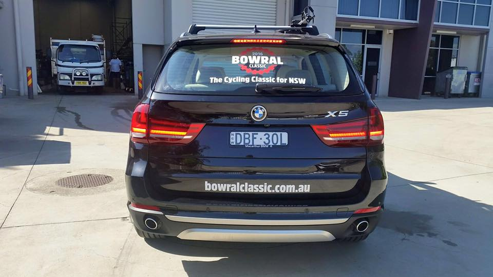 bowral classic signs on back of black car