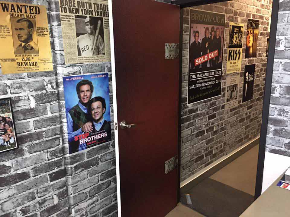 macarthur signs shop wood door and step brothers sign on brick wall