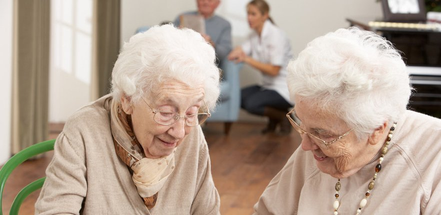 Two elderly ladies enjoying a chat