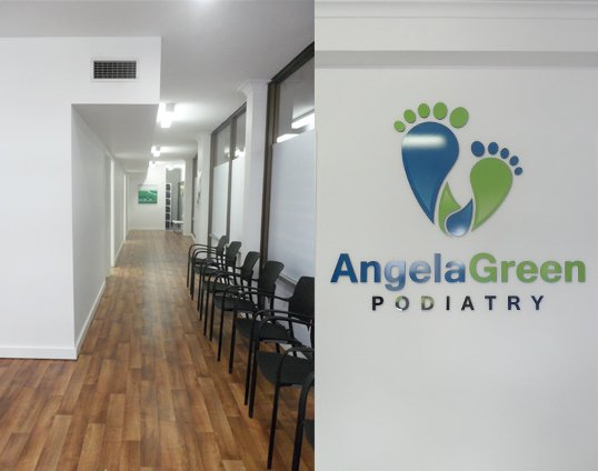 angela green podiatry chairs and business logo on the wall