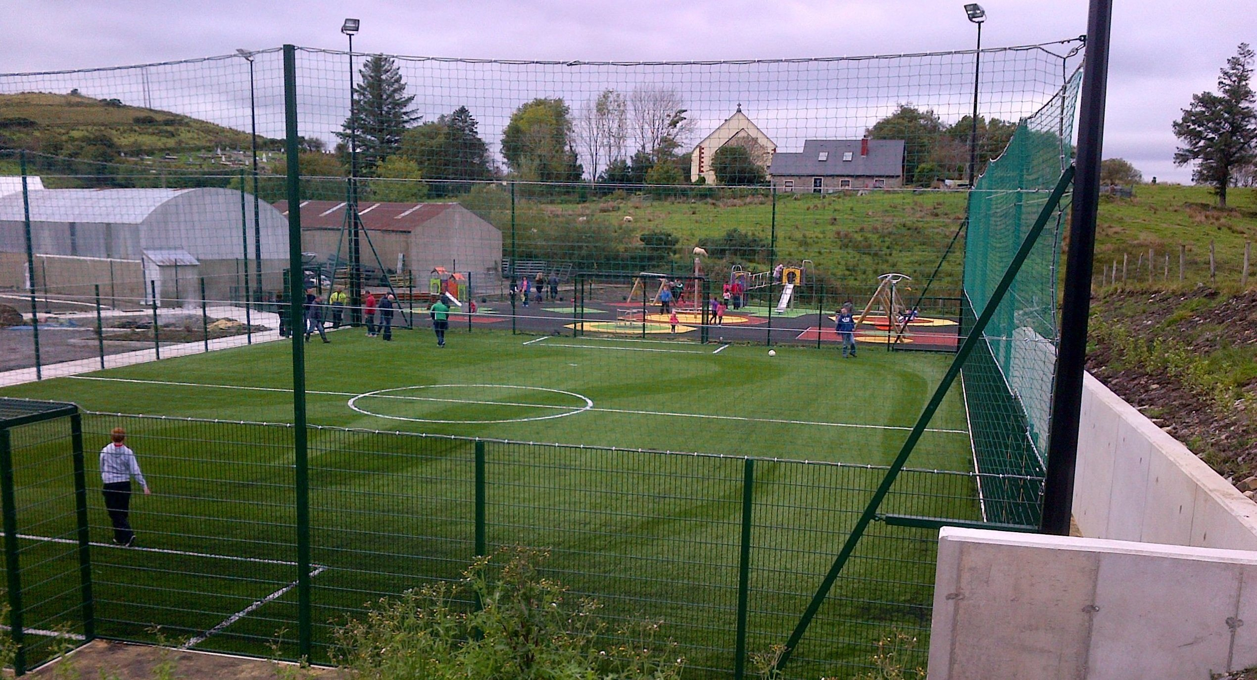 Boys playing on the football pitch