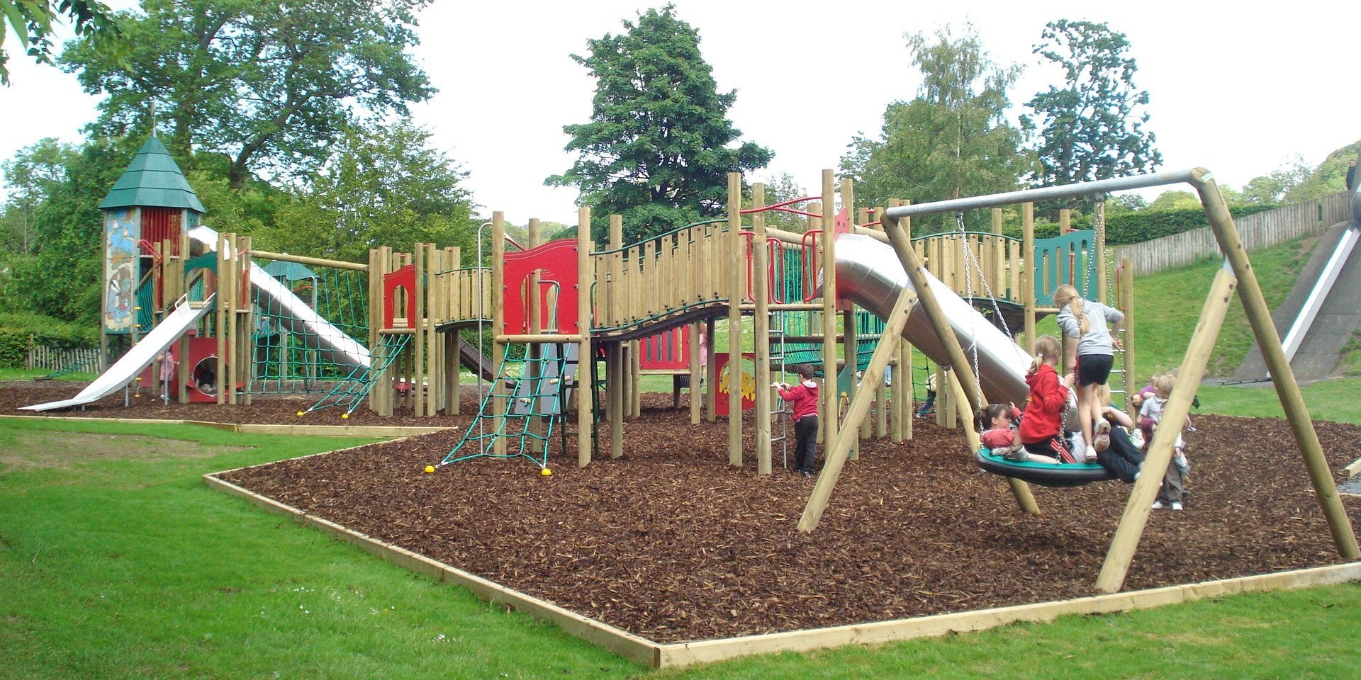 Play area with swings, slides and climbing frames