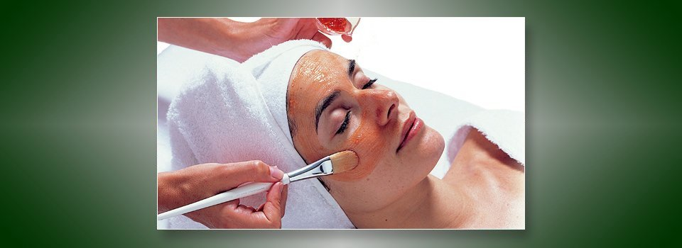 face body day spa and beauty salon applying facepack using a brush