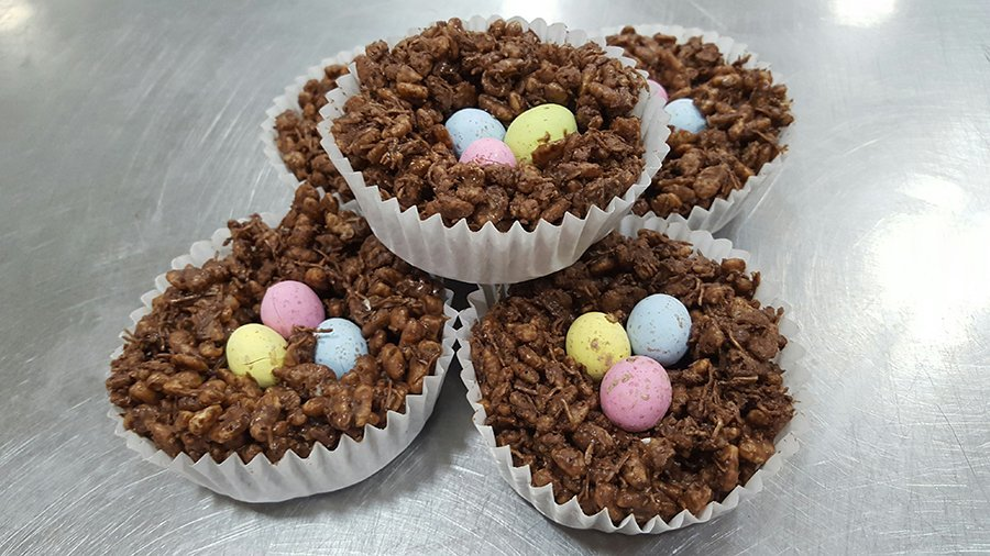 Rice crispy cakes topped with mini chocolate eggs