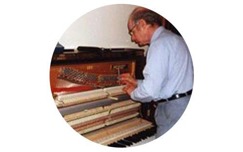 man-fixing-piano