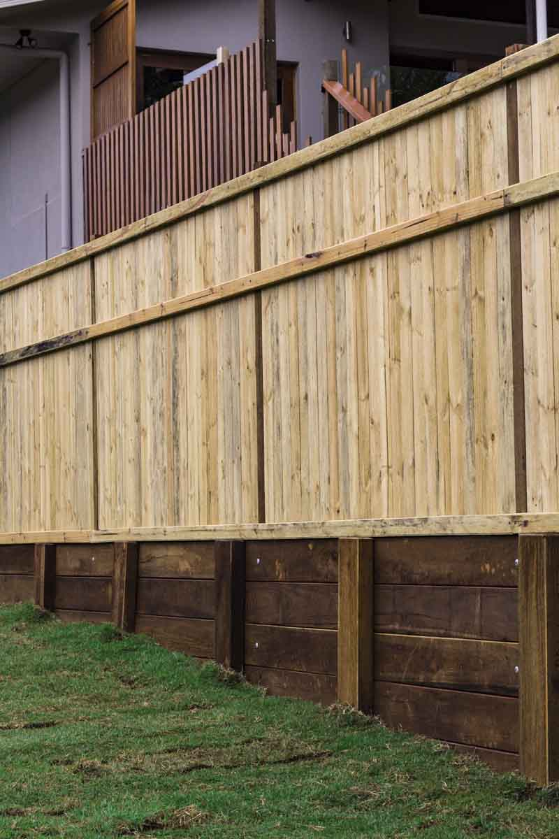 vertical view of raised fence on sloped lawn