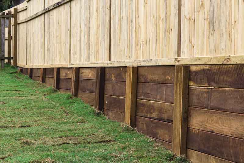 third view of raised wooden fence