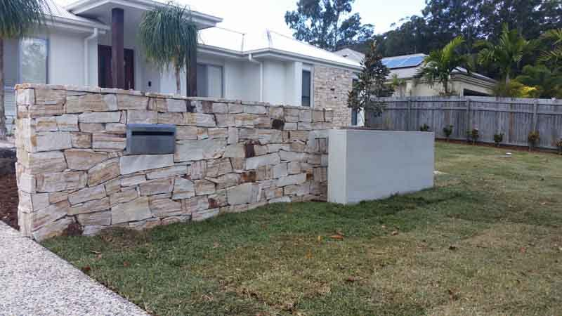 wall of stone in front of a house